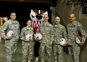 Five Soldiers with the Army National Guard pose with Bucky Jan. 18 at the Kohl Center before being recognized center-court as part of a mitliary appreciation game. (From left to right), Sgts. Bradley Bartha, Sgts. Cassandra Kautzmann, Michael Sentkowski, Sgt. 1st Class Niholas Kuechenmeister and Lt. Col. Michael Murphy were recognized for excellent military service and community involvement. Recruiters were also on hand prior to the game to pass out 2,500 camoflauge, Wisconsin Badgers hats. Wisconsin National Guard photo by Tech. Sgt. Jon LaDue